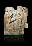 Roman Sebasteion relief sculpture of  Herakles is preparing to wrestle the Libyan giant Antaios. Aphrodisias Museum, Aphrodisias, Turkey.  Against a black background.<br /> <br /> Herakles (left) is taking off his bow case to hang it on a pillar statue. Antaios (right) is binding up his head with ear protectors, next to him stands an oil basin used in the palaistra (wrestling ground). Antaios was a famous wrestler who challenged and killed all visitors to his country, until he was defeated by Herakles. .<br /> <br /> If you prefer to buy from our ALAMY STOCK LIBRARY page at https://www.alamy.com/portfolio/paul-williams-funkystock/greco-roman-sculptures.html . Type -    Aphrodisias     - into LOWER SEARCH WITHIN GALLERY box - Refine search by adding a subject, place, background colour, museum etc.<br /> <br /> Visit our ROMAN WORLD PHOTO COLLECTIONS for more photos to download or buy as wall art prints https://funkystock.photoshelter.com/gallery-collection/The-Romans-Art-Artefacts-Antiquities-Historic-Sites-Pictures-Images/C0000r2uLJJo9_s0