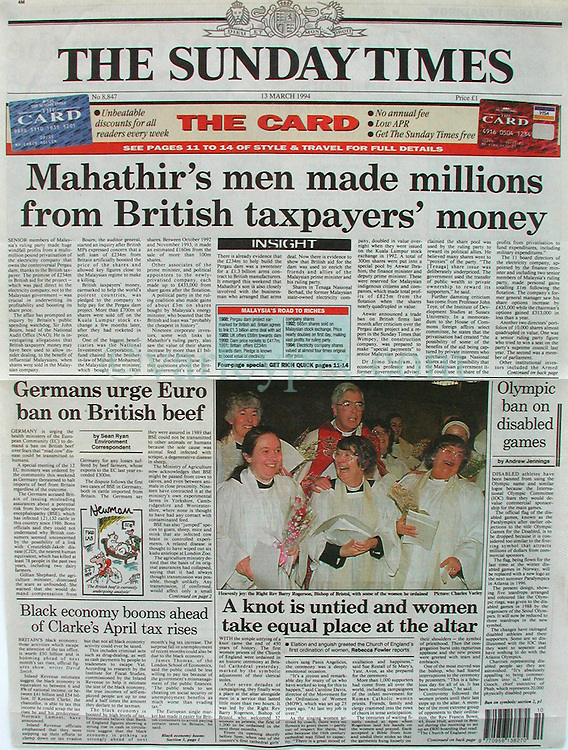 13th March 1994. Bristol, England, Great Britain.<br /> Sunday Times, London. Front page.<br /> Ordination of women priests. <br /> This was my first ever broad sheet front page, one that hadn't come easily. Earlier in the day I had been dispatched to Bristol Cathedral to cover history in the making. For the first time in 450 years, the Anglican Church had taken the bold and at the time extremely controversial descision to ordain women priests. The world's media descended on the story. In a frantic afternoon I covered events in the lead up to the big event. Lots of pomp and ceremony, but the main event was to come later in the day. I sent my film back to the bureau of South West News Service with my then deputy photo editor. A little later later I got a frantic call, my film was shit, thin and all washed out. Nothing could be used. WTF did I think I was playing at? 'Get your shit together or get another f''king job,' the deputy photo editor screamed down the phone. This was a bit rich for a man who rarely left the office and wasn't rated that highly as a shooter by my colleagues. A classic rookie mistake. I had been shooting an event the previous evening and bumped the ISO of my film, forgetting to reset it the following day. I was devastated. My girlfriend at the time was mad at me, yet again I had missed a dinner party in London. She was reaching the end of her tether, keys would be under the mat yet again! But the main event hadn't happened yet. Not until the Bishop handed them the official papers would the ladies formally be the first women priests to be ordained. The press had been banned from the catacombs of the great cathedral, yet a TV cameraman friend of mine from ITV and I had discovered a way down earlier in the day. We took a huge gamble to ignore the main event upstairs, instead opting to hang out in the catacombs where we knew the ceremony would be finalized despite the media ban. We risked being thrown out and getting nothing at all. I didn't have much to lose but my