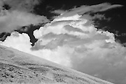 Infrared photograph of clouds against desert scrub in Benton County, WA.  Fine art photography by Michael Kloth. Black and white infrared photographs