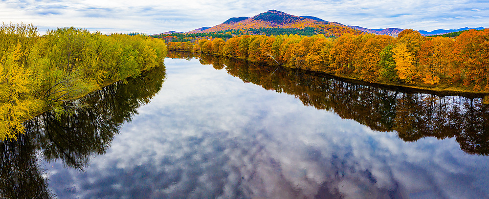 Panoramic aerial view of autumn leaf colors along the Androscoggin River, Bethel, Maine, New England, USA