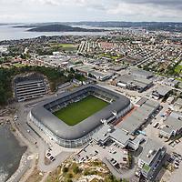 Sør Arena hjemme stadion til eliteserielaget Start iKristiansand sett fra luften en august dag.
