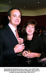 MR CHARLES BALFOUR and his sister in law LADY TESSA BALFOUR, daughter of the Duke of Norfolk, at a party in London on November 26th 1996.LTX 37
