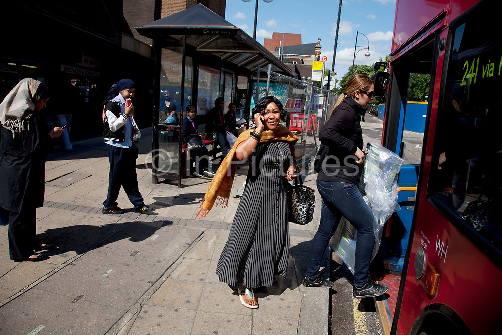 People waiting or queueing for a bus in Stratford in East London. This is a relatively poor area of London, but in recent years has seen much regeneration, the construction of a major transport hub and various shopping complexes. Stratford is adjacent to the London Olympic Park and is currently experiencing regeneration and expansion linked to the 2012 Summer Olympics. (Photo by Mike Kemp/For The Washington Post)