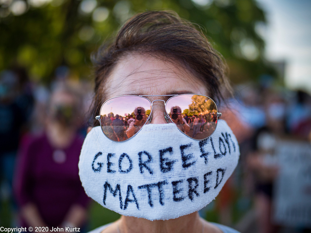 01 JUNE 2020 - DES MOINES, IOWA: A woman with a coronavirus face mask at a protest to support George Floyd at the Iowa State Capitol. About 1,000 people gathered in front of the Iowa State Capitol in Des Moines Monday evening for a rally calling for racial justice. The rally was one week after George Floyd, an unarmed black man, was killed by a Minneapolis police officer who knelt on Floyd's back for more than eight minutes. There were protests  in Des Moines all weekend against Floyd's killing. There was some violence and some people have been arrested but the protests in Des Moines haven't been as serious as protests in other cities.         PHOTO BY JACK KURTZ