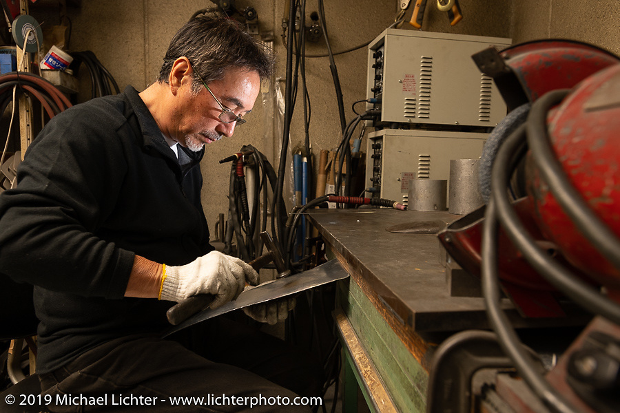 Master builder Keiji Kawakita works metal at his Hot Dock Customs in Tokyo during out Mooneyes Japan tour. Friday, November 30, 2018. Photography ©2018 Michael Lichter.