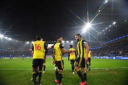 Watford's Troy Deeney (right) celebrates scoring his side's fifth goal of the game with team-mates during the Premier League match at the Cardiff City Stadium.