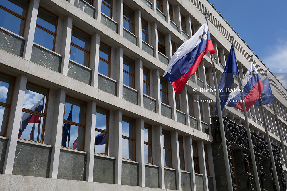 The exterior of the Slovenian People's And National Assembly (Parliament building), by Vinko Glanz (1960) in the Slovenian capital, Ljubljana, on 27th June 2018, in Ljubljana, Slovenia. <br /> Portal Sculptures are by Zdenko Kalin and Krel Putrih.