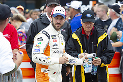 June 10, 2018 - Brooklyn, Michigan, U.S - NASCAR driver DANIEL SUAREZ (19) walks in the pit area at Michigan International Speedway. (Credit Image: © Scott Mapes via ZUMA Wire)