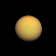 Titan's atmosphere makes Saturn's largest moon look like a fuzzy orange ball in this natural color view from the Cassini spacecraft. Titan.