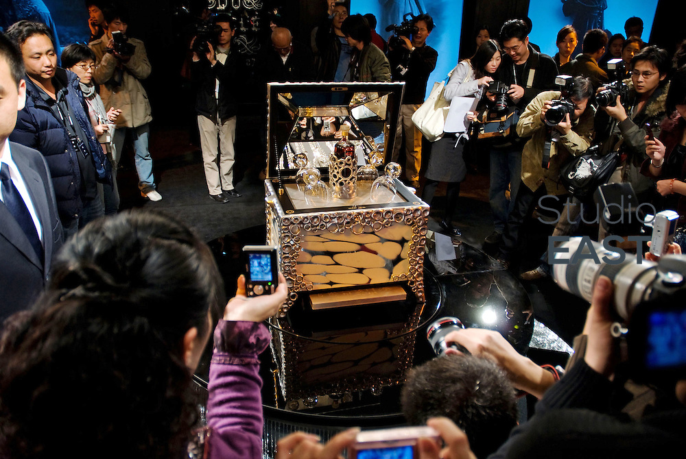 Photographers and visitors take pictures of a limited edition of a Hennessy Cognac bottle at the Top Show in Shenzhen, Guangdong province, China, on January 18, 2008. The set, designed by Jean-Michel Othoniel, with cups of Baccarat crystal, is valued 1.5 million Chinese yuans or 140,000 euros. The second Shenzhen World's Most Exclusive Luxury Show, also known as Top Show, displayed luxury goods from nearly 60 top international brands, including Ferrari, Rolls-Royce, Jaguar, Breguet, Glashutte, Hastens and Dux. The show attracted around 15,000 visitors. Photo by Vincent Assante Di Cupillo/Pictobank.