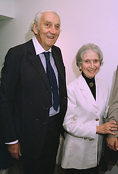 SIR NICHOLAS & LADY HENDERSON at a party in London on 26th September 1997.MBR 12