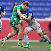 Chris Wyles, Saracens, is tackled by Alex Lexington, London Irish during the London Irish Vs Saracens Aviva Premiership Rugby match, the first Premiership game to be played overseas at Red Bull Arena, Harrison, New Jersey. USA. 12th March 2016. Photo Tim Clayton