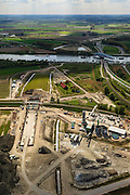 Nederland, Zeeland, Zeeuws-Vlaanderen, 09-05-2013; Sluiskil, Kanaal Gent-Terneuzen, kanaalkruising Sluiskil. Bouwpunt van de tunnel.<br /> De brug in de N61 sluit zeer regelmatig voor zeeschepen en dit veroorzaakt files. Daarom zal de kanaalbrug vervangen worden door een tunnel, de Sluiskiltunnel (oplevering 2015).<br /> The pivot bridge over the canal Gent-Terneuzen (Zeeland) closes very regularly for seagoing vessels and this causes traffic jams. Therefore, the canal bridge will be replaced by a tunnel, the tunnel Sluiskil (completion 2015).<br /> luchtfoto (toeslag op standard tarieven);<br /> aerial photo (additional fee required);<br /> copyright foto/photo Siebe Swart.