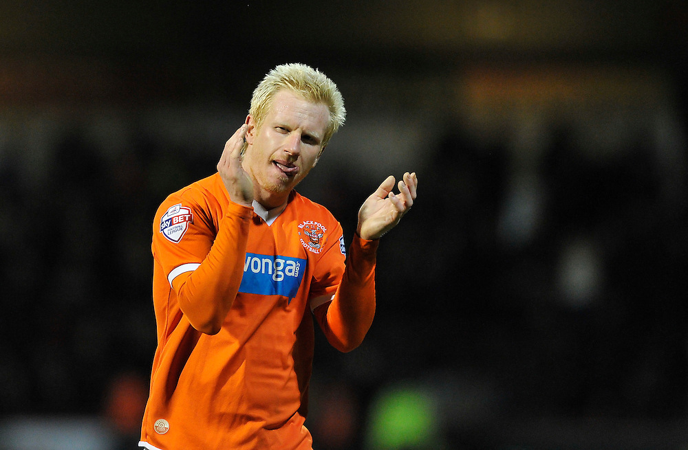 Blackpool's David Perkins applauds the travelling support after the 4-0 defeat to Brentford<br /> <br /> Photographer Ashley Western/CameraSport<br /> <br /> Football - The Football League Sky Bet League One - Brentford v Blackpool - Tuesday 24th February 2015 - Griffin Park - London<br /> <br /> © CameraSport - 43 Linden Ave. Countesthorpe. Leicester. England. LE8 5PG - Tel: +44 (0) 116 277 4147 - admin@camerasport.com - www.camerasport.com