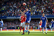 Cesar Azpilicueta of Chelsea heads the ball over Aaron Ramsey of Arsenal. Barclays Premier League match, Chelsea v Arsenal at Stamford Bridge in London on Saturday 19th September 2015.<br /> pic by John Patrick Fletcher, Andrew Orchard sports photography.