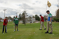 Mitchell Rogerson makes his putt on the 1st green with Zach Piotrowicz, Michael Mirabito and Michael Nogaj with the Fosters Golf Camp at Bolduc Park Friday morning.  (Karen Bobotas/for the Laconia Daily Sun)