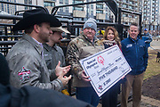 Professional Bull Riding makes a donation to Special Olympics during a presentation with Professional Bull Riding (PBR) 2020 Tour and Special Olympics Illinois (SOILL) in Chicago, Friday, Jan. 10, 2020, in Chicago in Maggie Daley Park. Matt West, Matt Triplett, Joe Renner, Kate Risley, and Chris Winston pose with the $5,000 check.  (Max Siker/Image of Sport via AP)