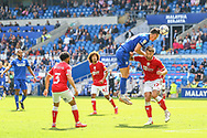 Cardiff City forward Kieffer More (10) heads over Bristol City's Nathan Baker (17) during the EFL Sky Bet Championship match between Cardiff City and Bristol City at the Cardiff City Stadium, Cardiff, Wales on 28 August 2021.