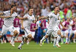 Russia's (left-right) Aleksandr Yerokhin, Roman Zobnin and Fyodor Smolov celebrate defeating Spain 3-4 on penalties