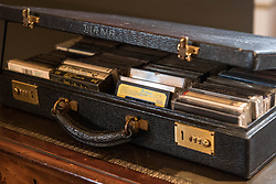 Embargoed to 0001 Friday July 21<br /> A case of cassette tapes of the music of the likes of Diana Ross, Elton John and George Michael on the desk from the Kensington Palace sitting room of Diana, Princess of Wales during a preview for the Royal Gifts exhibition, which is part of the annual Summer Opening of the State Rooms at Buckingham Palace, London.