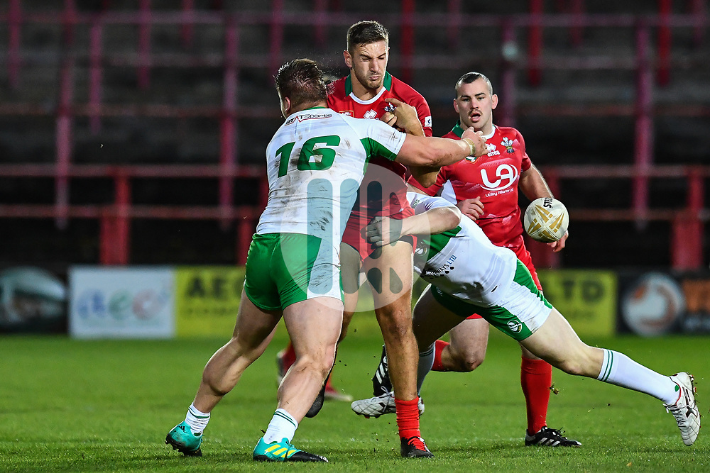 11th November 2018 , Racecourse Ground,  Wrexham, Wales ;  Rugby League World Cup Qualifier,Wales v Ireland ; Gavin Bennion of Wales is tackled by Gareth Gill of Ireland <br /> <br /> <br /> Credit:   Craig Thomas/Replay Images