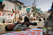 Man sleeps on cardboard in Zi Zhong Road, old Shanghai, China
