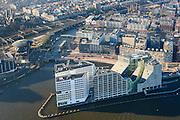 Nederland, Noord-Holland, Amsterdam, 11-12-2013; Westerdoksdijk met IJdok. Op het kunstmatige schiereiland IJDock bevindt zich het Paleis van justitie voor het Gerechtshof van Amsterdam. Op het tweede plan de nieuwbouw van het Westerdok en daar achter het Bickerseiland en Prinseneiland.<br /> Articial island build for Palace of Justice - the Amsterdam Court of Justice.  Former harbour area, newly developed residential area.<br /> luchtfoto (toeslag op standaard tarieven);<br /> aerial photo (additional fee required);<br /> copyright foto/photo Siebe Swart.