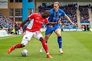 Charlton Athletic defender Naby Sarr (23) and Gillingham FC forward Tom Eaves (9) during the EFL Sky Bet League 1 match between Gillingham and Charlton Athletic at the MEMS Priestfield Stadium, Gillingham, England on 27 April 2019.