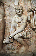 Close up of Roman Sebasteion relief  sculpture of Meleager and Atalante  Aphrodisias Museum, Aphrodisias, Turkey.    <br /> <br /> Meleager sits on a rock tying his sandal. Below him lies a fierce hunting dog with a broad collar. On one side a god or another hero wearing a rounded hat was crowning Meleager ( arm missing). On the other side stands the huntress Atalante, Meleager's lover: she wears a short dress and quiver, and lifts her cloak at the shoulder in a gesture of modesty. .<br /> <br /> If you prefer to buy from our ALAMY STOCK LIBRARY page at https://www.alamy.com/portfolio/paul-williams-funkystock/greco-roman-sculptures.html . Type -    Aphrodisias     - into LOWER SEARCH WITHIN GALLERY box - Refine search by adding a subject, place, background colour, museum etc.<br /> <br /> Visit our ROMAN WORLD PHOTO COLLECTIONS for more photos to download or buy as wall art prints https://funkystock.photoshelter.com/gallery-collection/The-Romans-Art-Artefacts-Antiquities-Historic-Sites-Pictures-Images/C0000r2uLJJo9_s0