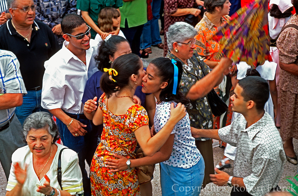 PUERTO RICO, FESTIVALS Three KIngs Festival on Jan 6th in town of Juana Diaz near Ponce; crowds of spectators greeting each other at mass