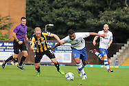 Bury's Anton Forrester ® goes past Southend's defender John White. Skybet football league two match, Bury v Southend Utd at Gigg Lane in Bury, England on Sat 21st Sept 2013. pic by David Richards/Andrew Orchard sports photography