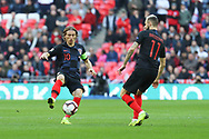 Croatia's Luka Modric controlling the ball and passing to Croatia's Marcelo Brozovic during the UEFA Nations League match between England and Croatia at Wembley Stadium, London, England on 18 November 2018.