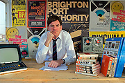 Mr Norman Cook, chairman of the BPA, at his office desk.
