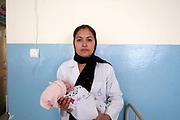 Afghanistan. Mazar-e-Sharif maternity hospital. Dr Nelab Tokhi, 30 , doctor with newborn baby girl