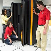 Marist College School of Computer Science & Mathematics students (from left) Paula Batoon, Dominic Rosillo and Charles Hall inspect the school's IBM LinuxONE system. Marist is one of three universities around the world that will host the IBM LinuxONE Developer Cloud, which provides developers access to a virtual IBM LinuxONE at no cost to create and test applications. IBM also is working with academic and corporate partners to host a Master the Mainframe programming contest in 47 countries this year to reach next-generation developers. (Jon Simon/Feature Photo Service for IBM)