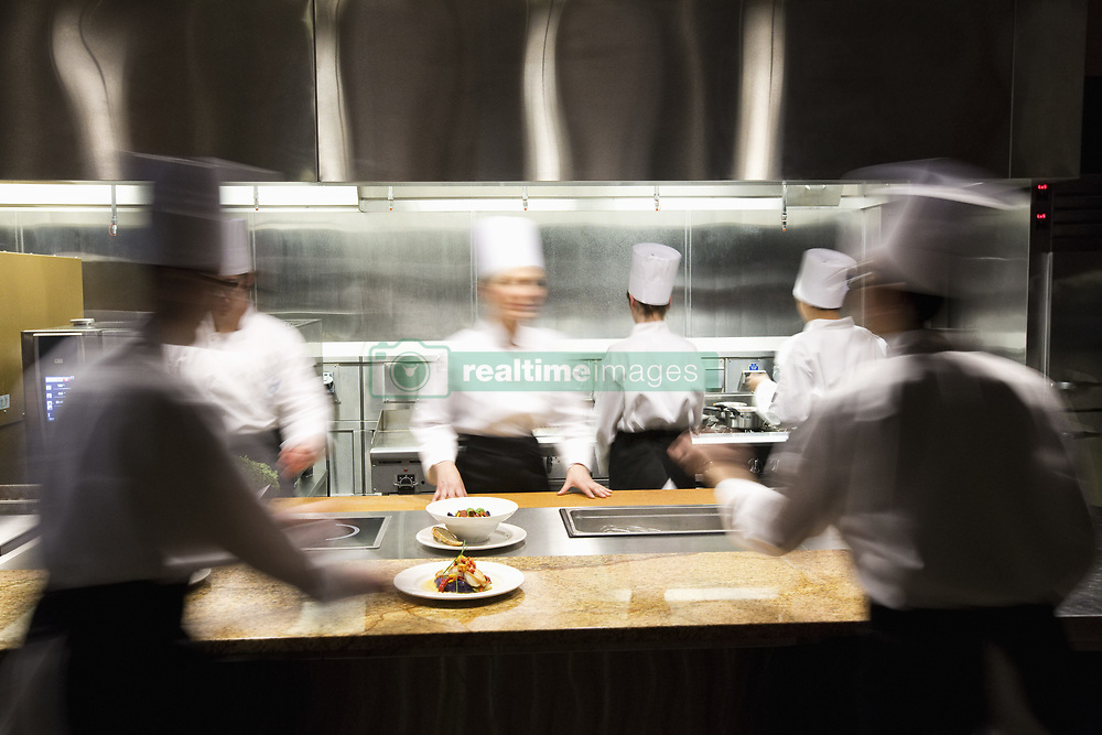 March 29, 2013 - A blurred view of a crew of  chefs working around a commercial kitchen. (Credit Image: © Mint Images via ZUMA Wire)