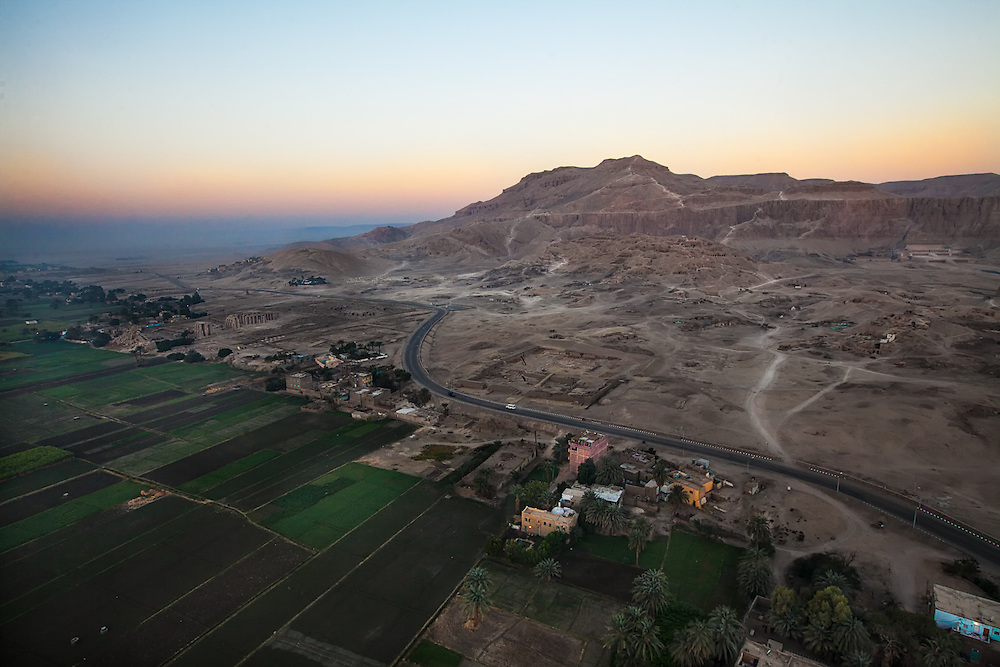 EGYPT. Luxor. December 27th, 2013.  An aerial view of the Valley of the Kings and the highway separating the fertile farm land from the ancient Pharaohss tombs.