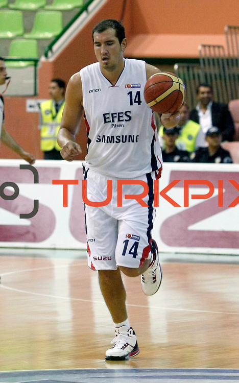 Efes Pilsen's Kaya PEKER during their Turkish Basketball league Play Off semi final first match Efes Pilsen between Besiktas at the Ayhan Sahenk Arena in Istanbul Turkey on Sunday 09 May 2010. Photo by Aykut AKICI/TURKPIX