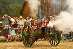 September 2, 2017 - Elkton, OREGON, U.S - Children and adults cover their ears as a cannon is fired outside a replica of the Fort Umpqua trading post in Elkton during the Fort Umpqua Days festival. The original Fort Umpqua was a trading post built by the Hudson's Bay Company in the company's Columbia District, in what is now the U.S. state of Oregon in 1832 near this site in Elkton. (Credit Image: © Robin Loznak via ZUMA Wire)