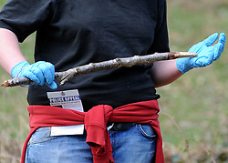 ©London News pictures. 22/03/11.  An appeal flyer is tucked into a volunteers jumper. Locals and friends of Sian O'Callaghan help Police in the search in Savernake Wood, Wiltshire, today. Detectives continue investigating the disappearance of office administrator Sian O'Callaghan. The 22-year-old disappeared after leaving Suju nightclub in Swindon at about 2.50am on Saturday to walk the half-mile home to the flat she shared with her boyfriend Kevin Reape. Picture Credit should read Stephen Simpson/LNP
