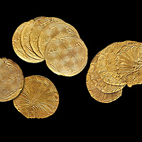 Mycenaean Gold circular buttons from Grave IV, Grave Circle A, Myenae, Greece. National Archaeological Museum Athens. 16th Cent BC. Black Background