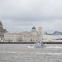 LIVERPOOL, UK, 23rd May, 2013. HMS Example heads out on the Mersey to greet HMS Bulwark and fleet as they arrive for the Battle of the Atlantic 70th anniversary celebrations.