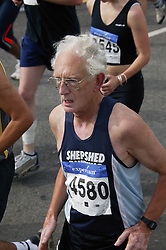 Older man running runner in the Nottingham Robin Hood Marathon; held every year and starting and finishing at the Victoria Embankment,