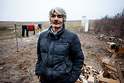 Portrait of Rudolf (52) at the construction side of their house. He, his wife and their son with three children (2014) are among those who joined the micro loan program in Rankovce. Rudolf is educated as a gardener and since the fall of communism he has not been able to get a permanent job.