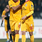 Galatasaray's Felipe Melo (L) and Sercan Yildirim (R) during their Turkish Superleague soccer match Genclerbirligi between Galatasaray at the 19 Mayis stadium in Ankara Turkey on Saturday 03 December 2011. Photo by TURKPIX