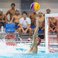Bryan (#1) of Raffles attempts to block a shot made by a Hwa Chong player. (Photo © Jerald Ang/Red Sports)
