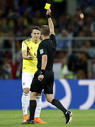 (l-r) Santiago Arias of Colombia, referee Mark Geiger during the 2018 FIFA World Cup Russia round of 16 match between Columbia and England at the Spartak stadium  on July 03, 2018 in Moscow, Russia