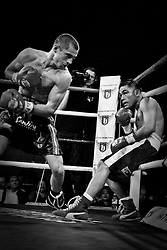 Scott Quigg puts the pressure on backing Varela up against the ropes.