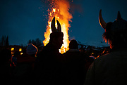 Ullr Fest attendees crowd around a bonfire after the parade in Breckenridge, Colorado. The bonfire was comprised of Christmas trees that people donated to be burned.