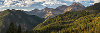 Panoramic view of Mount Timpanogos from American Fork Canyon furing Fall in Utah. The expansive mountain and canyon spreads out giving the viewer a dramatic view of its immense size.